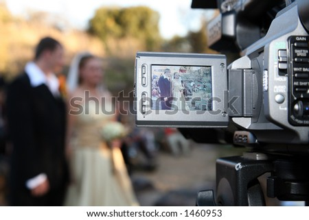 Wedding Couple on being recorded on camera - stock photo