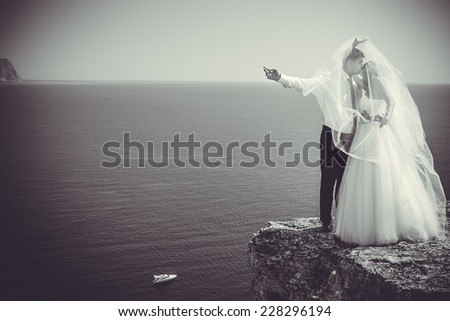 Wedding couple on sea background - stock photo