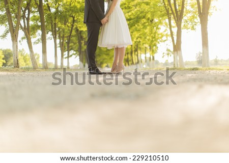 Wedding couple on the country road - stock photo