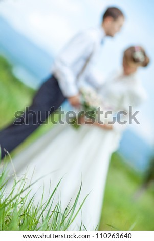 Wedding couple on the nature - stock photo