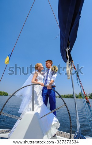 Wedding couple on yacht
