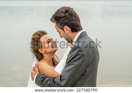 Wedding couple outdoor with lake on background