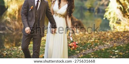 Wedding couple outside.  - stock photo