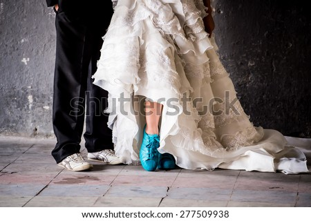 Wedding couple shoes closeup white high heeled and navy black,Groom Dresses red wedding shoes bride   - stock photo