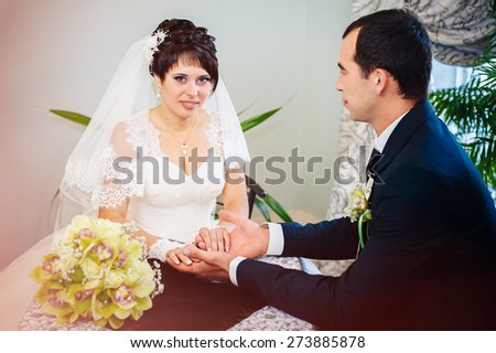 wedding couple sitting in a cafe on their wedding day. - stock photo