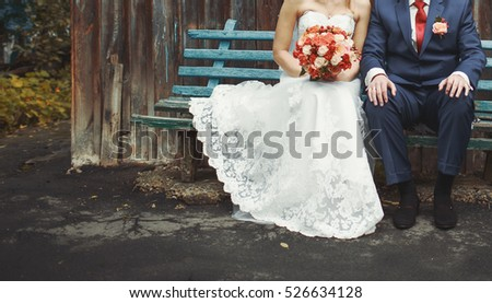 wedding couple sitting on a bench