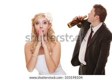 Wedding couple, unhappy bride with alcoholic drinking groom. Woman looking her future make decision - violence alcoholism problems concept - stock photo