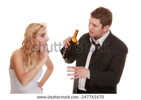 Wedding couple, unhappy bride with alcoholic drinking groom. Woman looking her future - violence alcoholism problems concept - stock photo