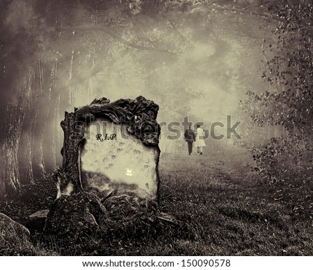 Wedding couple walking away from a grave in a forest