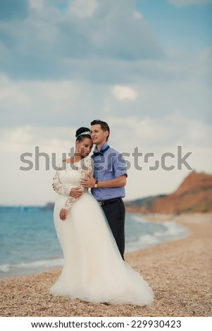 Wedding couple walking on a beautiful beach