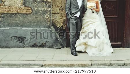 Wedding couple walking on the street  - stock photo