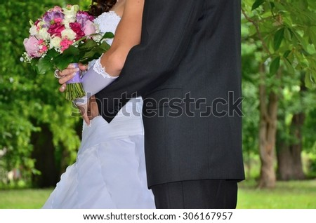 Wedding couple with beauatiful bouquet in their hands