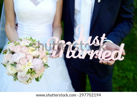 Wedding couple with bouquet. Female and male portrait. Beautiful model girl in white dress. Man in suit. Beauty bride with groom. Woman in bridal gown. Cute lady and guy outdoors - stock photo