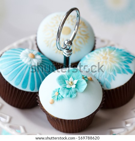 Wedding cupcakes on a cake stand - stock photo