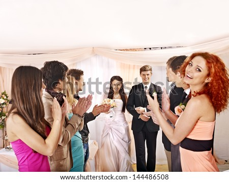 Wedding dance. Group people clap their hands. - stock photo
