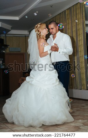 wedding dance of bride and groom. Charming bride and groom on their wedding celebration in a luxurious restaurant.
