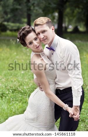 Wedding dance of bride and groom outdoor  - stock photo