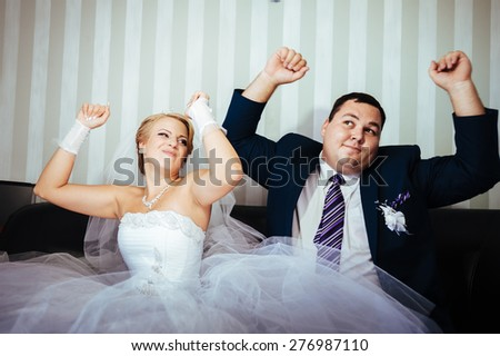 Wedding dance of charming bride and groom on their wedding celebration in a luxurious restaurant. - stock photo