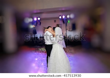 Wedding dance of young couple in restaurant - stock photo