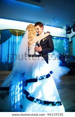 Wedding dance the bride and groom on a blue background - stock photo