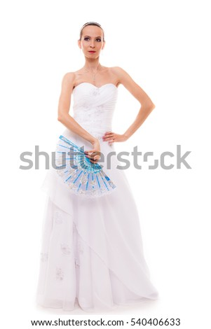 Wedding day. Full length young attractive romantic bride in white dress with blue fan isolated on white background