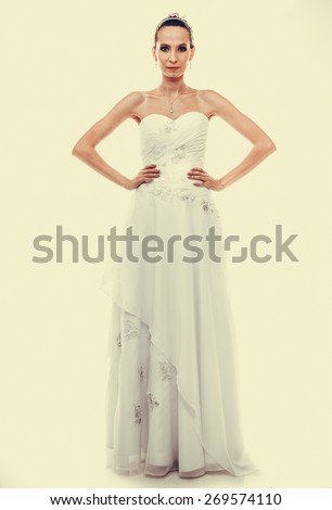 Wedding day. Full length young attractive romantic bride in white gown instagram filter