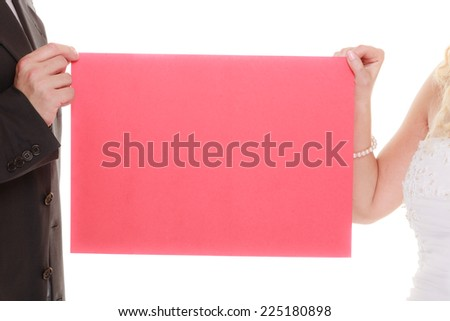Wedding day. Happy bride and groom holding sign red blank copy space for text isolated on white background