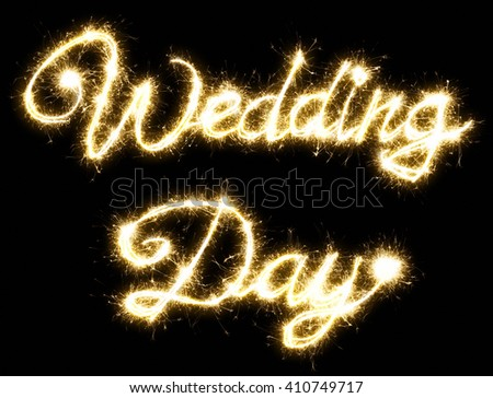 Wedding Day lettering made of sparkler. Isolated on a black background