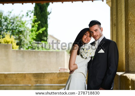 wedding day of a cheerful married young couple bride and groom