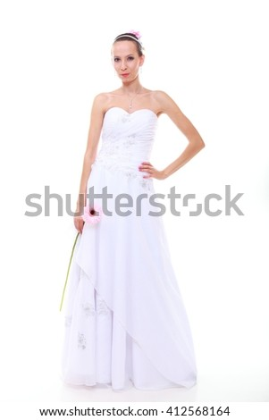 Wedding day. Young attractive romantic bride with pink flower gerbera daisy isolated on white background