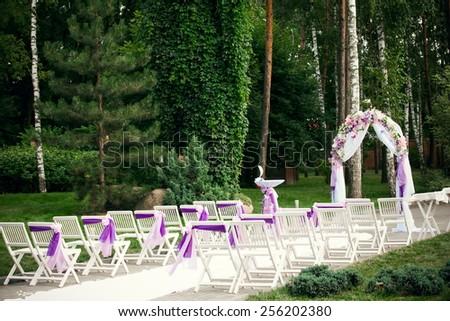 Wedding decor at outdoor wedding ceremony  - stock photo