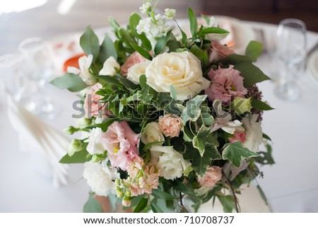 Wedding decor. Flowers in the restaurant, table setting