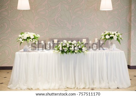 Flower bouquet arrangement on wedding table stock photo 691257994 wedding decor in the interior white flowers on the table serving the table with junglespirit Image collections