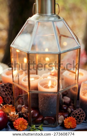 wedding decor with candles and dry flowers - stock photo