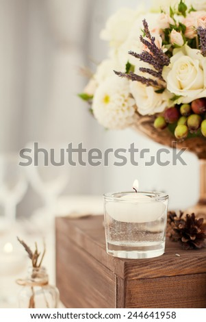 wedding decor with flowers and candles - stock photo