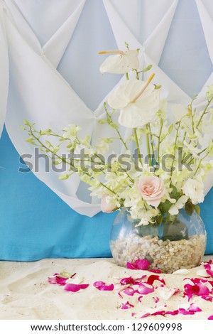 wedding decorated table and set up on beach - stock photo
