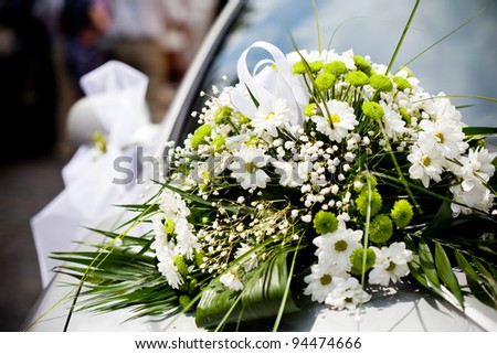 Wedding decoration closeup on the car - stock photo
