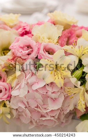 Wedding decoration. Flowers,bouquet in front of wedding background. Table set for wedding or another catered event dinner.