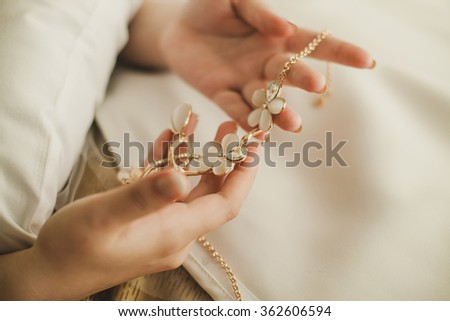 Wedding decoration in the hands of the bride