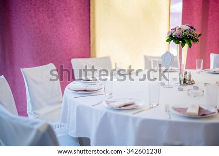 Wedding decoration with flowers in vase on a table