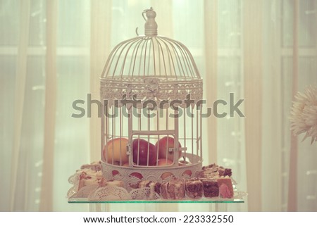 Wedding decorations, cookies and apples on the wedding table - stock photo