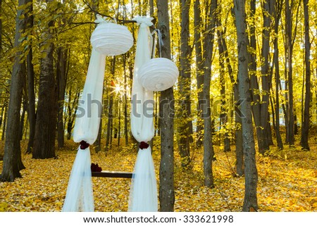 Wedding decorations in autumn forest. Beautiful wedding ceremony in autumn forest. Wedding Design elements.