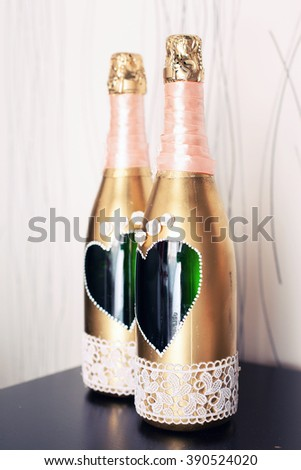 wedding decorative bottles of champagne on a holiday table