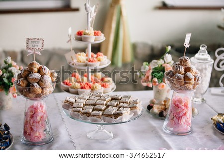 Dessert bar stock images royalty free images vectors shutterstock wedding dessert with delicious cake pops and different sweets candy bar junglespirit Images