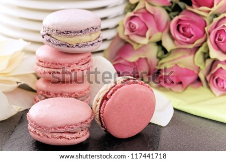 wedding dessert with macaroons and roses - stock photo