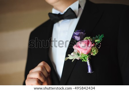 wedding details - elegant groom dressed wedding tuxedo costume is waiting for the bride