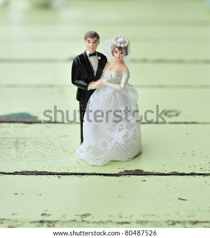 wedding doll on green wood table - stock photo