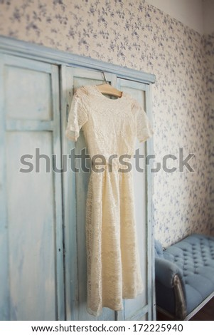 wedding dress bridal and white cat in room - stock photo