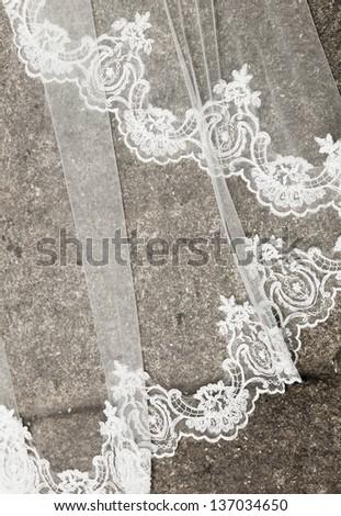 Wedding dress detail on the soil. The photo is taken outdoors. - stock photo