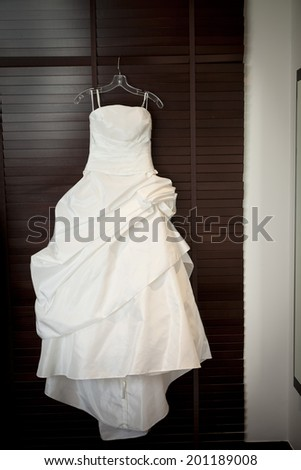 Wedding dress hang on closet door